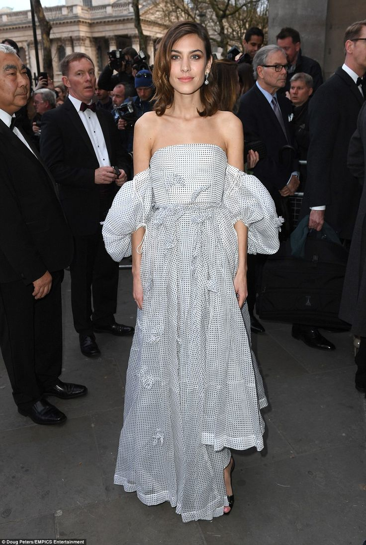 Alexa Chung looked captivating in an unusual voluminous, polka dot, off-the-shoulder dress as she arrived for the glittering gala