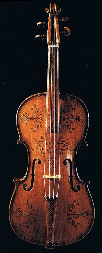 ...'s violin has to be the symbol of art in it's entirety. She's carved, drawn, played and shaped it. It's a perfect unity between artwork and performance. This is a real violin, BTW.