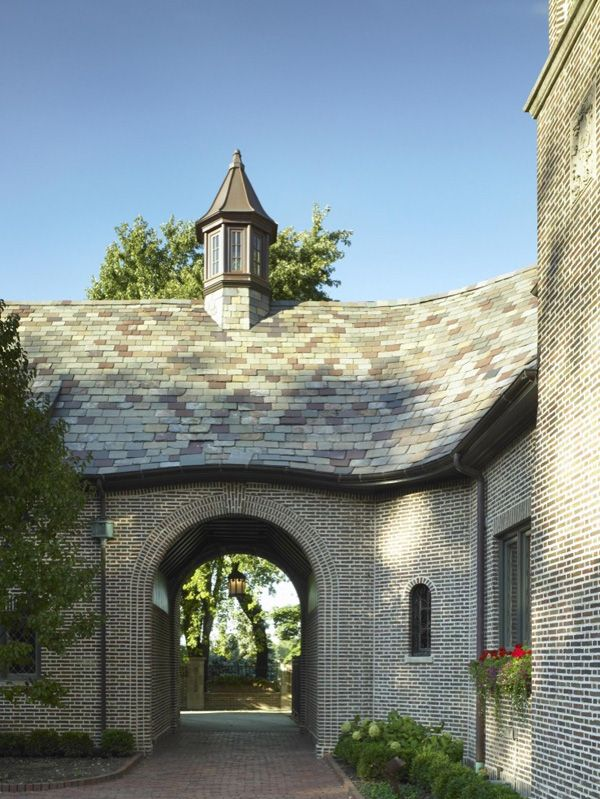 Our second trifecta -- lovely cupola, above a beautiful slate roof, above another porte cochere!