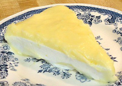 CHARSKI'S LEMON CURD - (pictured on this low carb cheesecake -  http://www.genaw.com/lowcarb/lemon_dream_cheesecake.html   (the lemon curd tastes like the filling in a lemon meringue pie and very tart. Easy! Will keep in fridge up to 3 weeks. Per serving with liquid Splenda  4.5g Net Carbs, with granular Splenda 12 carbs