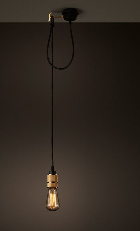 Modern pendant light bulb with brass fitting and black wire