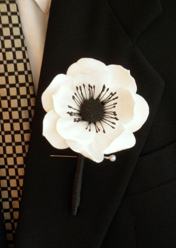 Anemone boutonniere for groomsmen and ushers. Want it exactly like this. Simple but beautiful :)