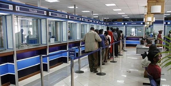 RECESSION: Nigerian Banks and Companies reduce workers salaries.    Nigerian banks are one of the hardest hit in the recession ravaging the country  A report by The Punch indicates that Diamond Bank Plc Heritage Bank Plc Zenith Bank Plc First Bank Plc and Wema Bank Plc have all reduced their workers salaries as of August 31. While Diamond Bank and Heritage Bank were said to have slashed salaries by 30 per cent First Bank and Wema Bank reportedly slashed workers salaries were by 20 per cent each. The banks decision were made in order to meet deposit targets which have become high in recent time. Hence workers who failed to meet their targets had their salaries slashed. The report also revealed that the same decision has been taken in some insurance companies. Before now the marketing departments of the underwriting firms and insurance agents were responsible for generating premium for the companies but it has been extended to all employees. Sources quoted said insurance workers in the marketing department who failed to meet their premium targets also had their salaries slashed.Before it was only the marketers that they used to give targets to. Now some of us also have targets ranging between N40 000 and N100 000 monthly and our promotion and salaries are tied to our performance an insurance worker squealed. A worker in one of the new generation banks also said she resumed work after her annual vacation only to discover that she didnt get the same salary that she had always received.There is perpetual fear in all banks. Every category of workers in the banks is affected by the economic crisis another bank employee noted. He also revealed that some bank workers had been resigning and travelling abroad especially the United States and Canada to avoid being sacked.One of my colleagues just resigned last month because of the fear of losing his job and travelled to the U.S to seek greener pastures. But those who are not interested in leaving Nigeria have devised many means