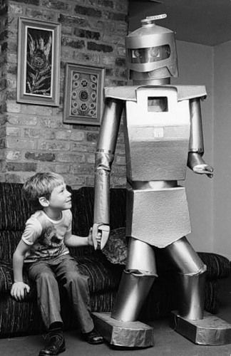 January 1981:  Mr Robotham, a radio-controlled robot built by technical journalist Peter Holland, makes friends with the inventor's son, James.