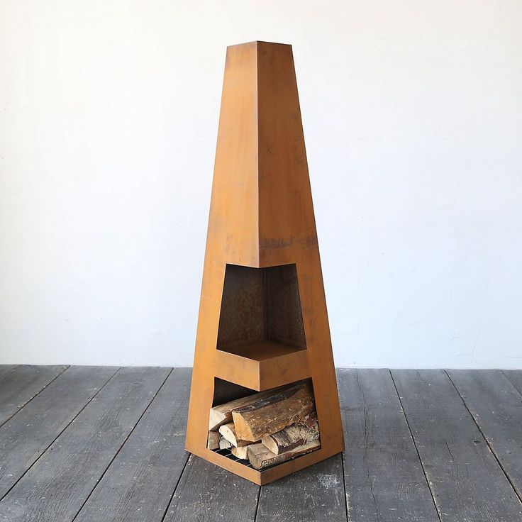 A strikingly modern addition to the patio, this geometric chiminea features a storage space for wood below the firebox. Each chiminea is constructed f