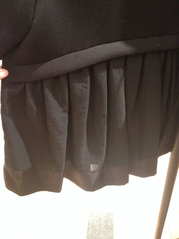 Loose pleats emerging from under panel on back of top. -Would this work in reverse with the pleats at the top and a panel at the bottom?