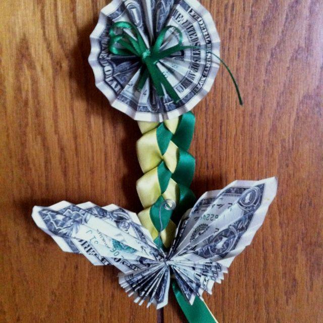 Folded dollar bills for a decorative graduation gi…