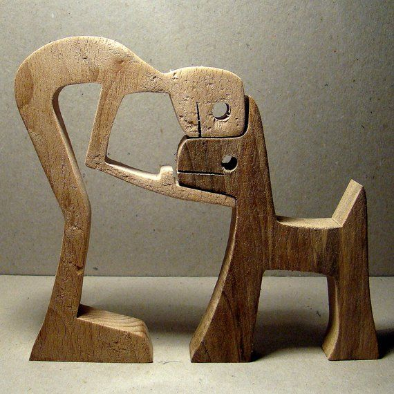 A man a dog; wood carving wripped