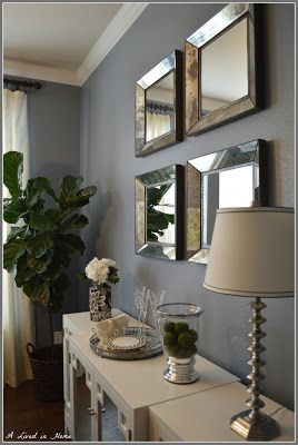 The bluish gray for the dining room just makes it a little more formal. I love the silver with it.