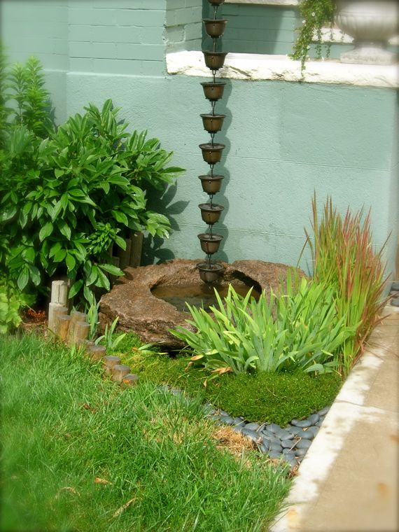 Rain chain. put it above a barrel and use the water collected to water your plants!