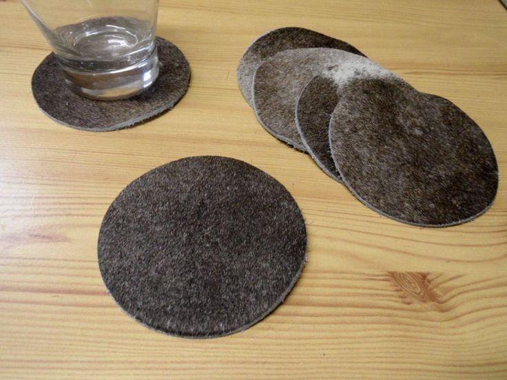 6 Untersetzer aus Kuhfell grau 10cm rund  von DieFellschmiede via dawanda.com