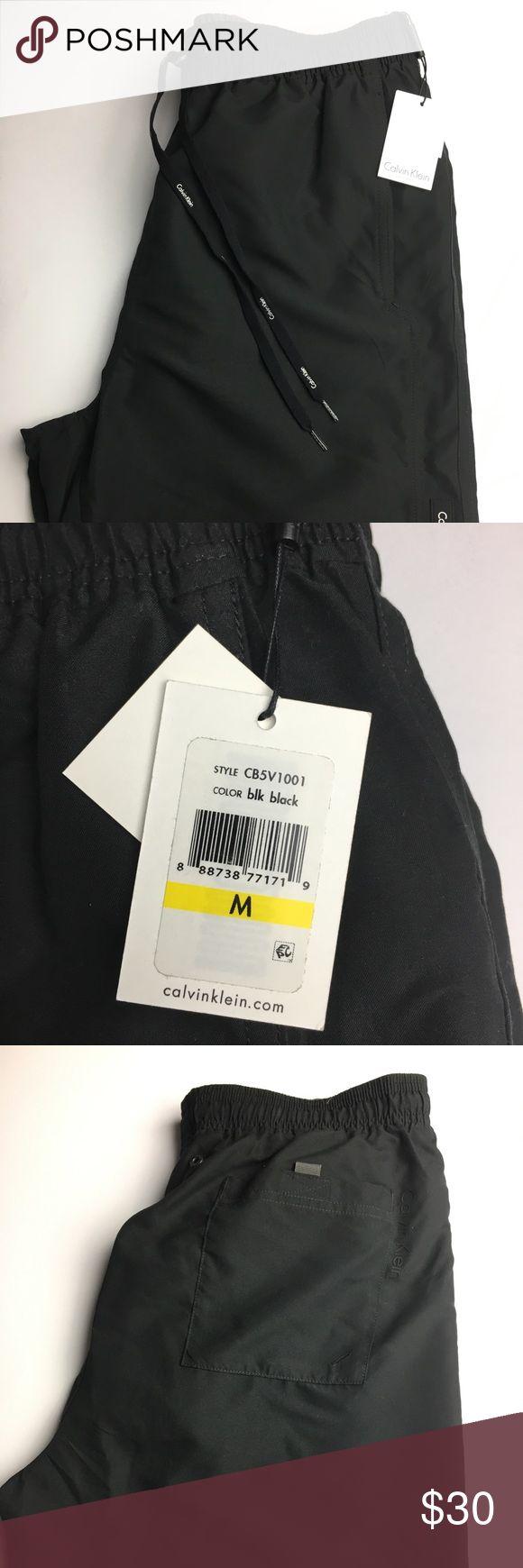 Calvin Klein Swim Shorts Black swim shorts with elastic plus drawstring waist. One back pocket with Velcro closure. Calvin Klein Swim Swim Trunks