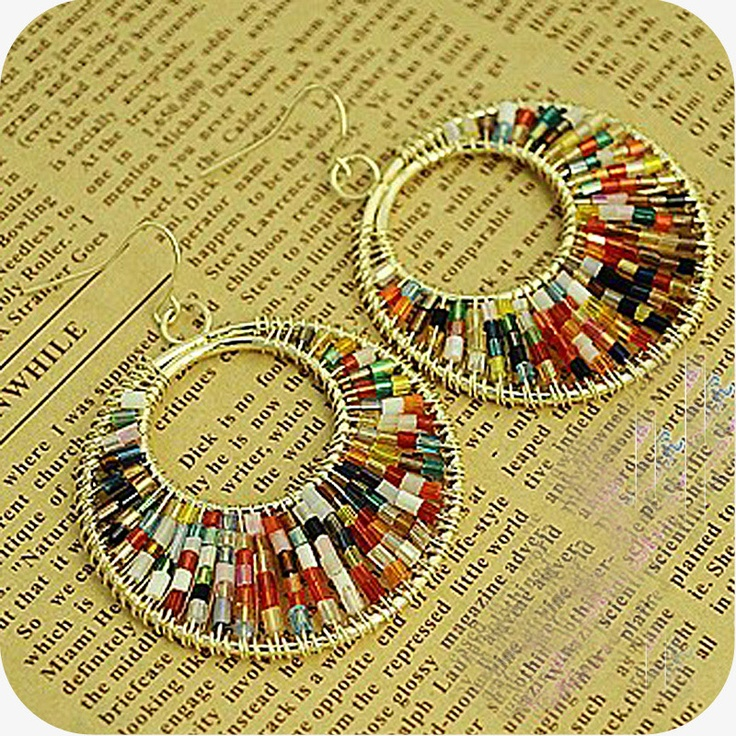 Beaded Earrings..I want to learn to make these. Not that I really wear earrings, but who wouldn't like them as a gift?