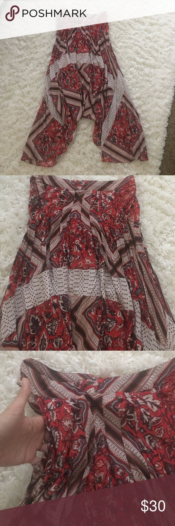 Free people skirt Beautiful red free people skirt! I bought on posh mark and it came with unadvertised flaws🙄. Please note two small holes at pleat in back of skirt. Very hard to see especial with the flow of this dress but they are there. As my selling price reflects. Free People Skirts Midi