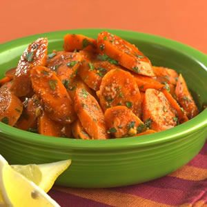 North African Spiced Carrots    1 tablespoon  extra-virgin olive oil  4 cloves  garlic, minced  2 teaspoons  paprika  1 teaspoon  ground cumin  1 teaspoon  ground coriander  3 cups  sliced carrots, (4 medium-large)  1 cup  water  3 tablespoons  lemon juice  1/8 teaspoon  salt, or to taste  1/4 cup  chopped fresh parsley