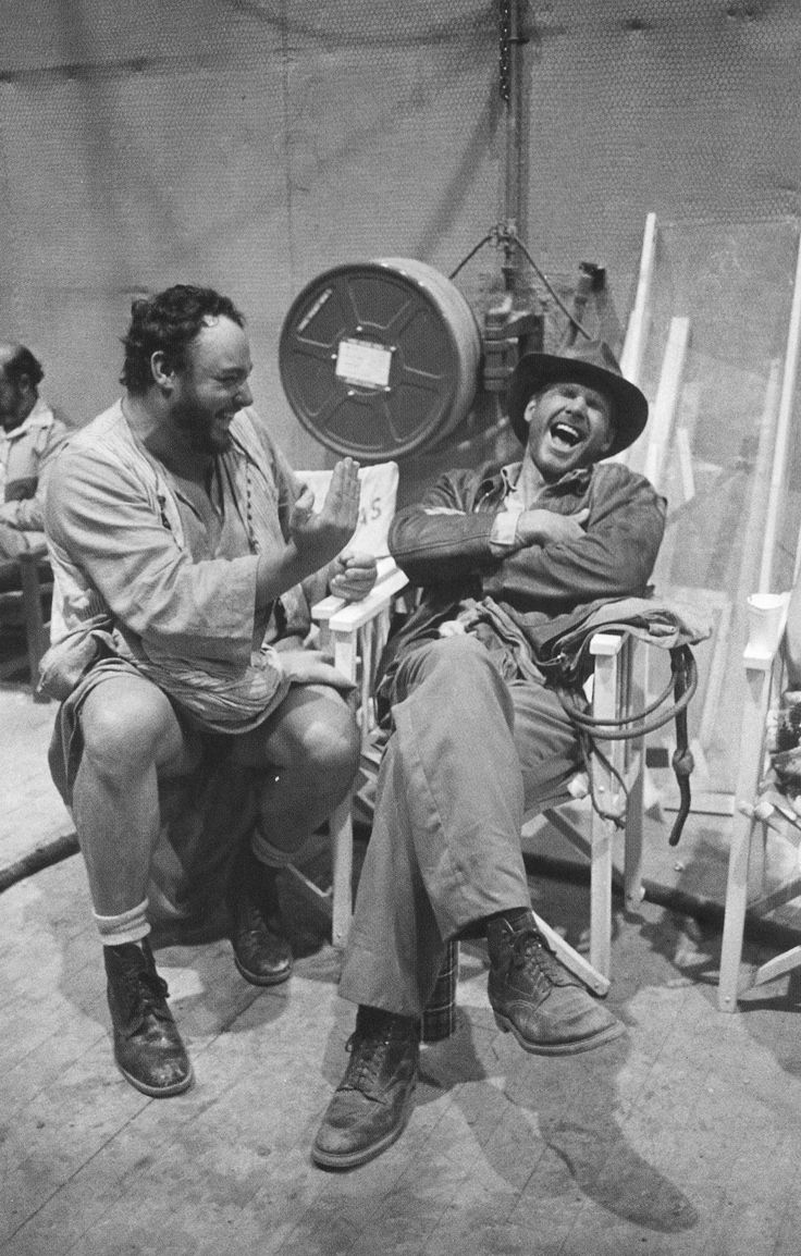 John Rhys-Davies and Harrison Ford between takes on Raiders of the Lost Ark