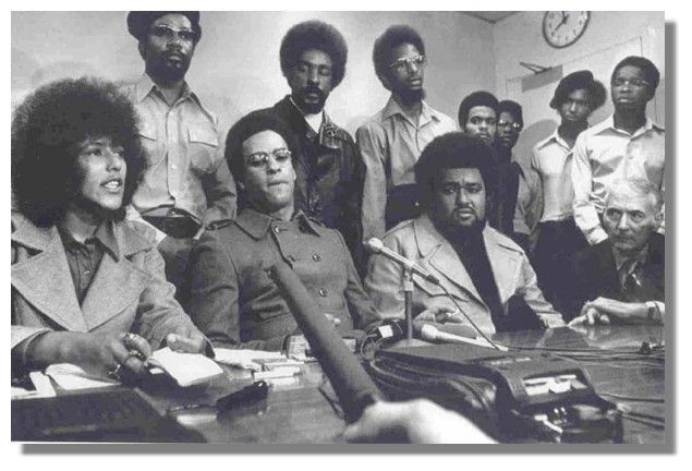 Elaine Brown (bottom left) and to her side Huey P. Newton leading the Black Panthers at a press conference in San Francisco. (October 1971)