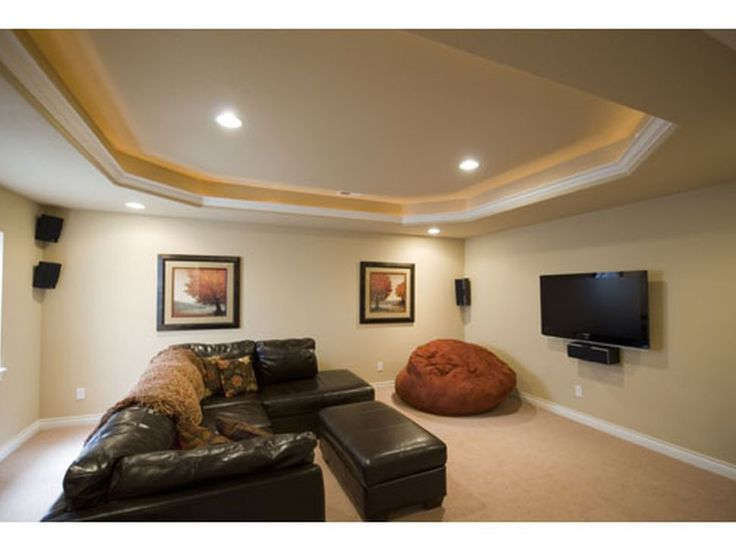 Architecture:Charming Living Room Basement Finishing Ideas With Ceiling Lights And Floating Flat Screen Tv With Home Theater Speaker Feat Brown Lounge Chairs And Black Long Sofas Plus Cushions Also Pictures Frames And Wooden Floor The Coolest Basement Finishing Ideas for Your On – going Remodeling Basement