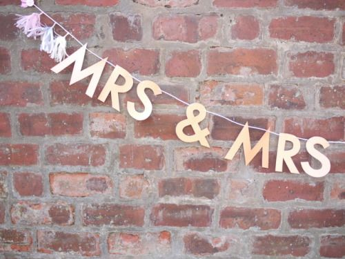 Close-up on a MRS & MRS wedding banner - plus custom tassels!  Luxury handmade wedding decor by Paper Street Dolls  Check out our store - paperstreetdolls.etsy.com