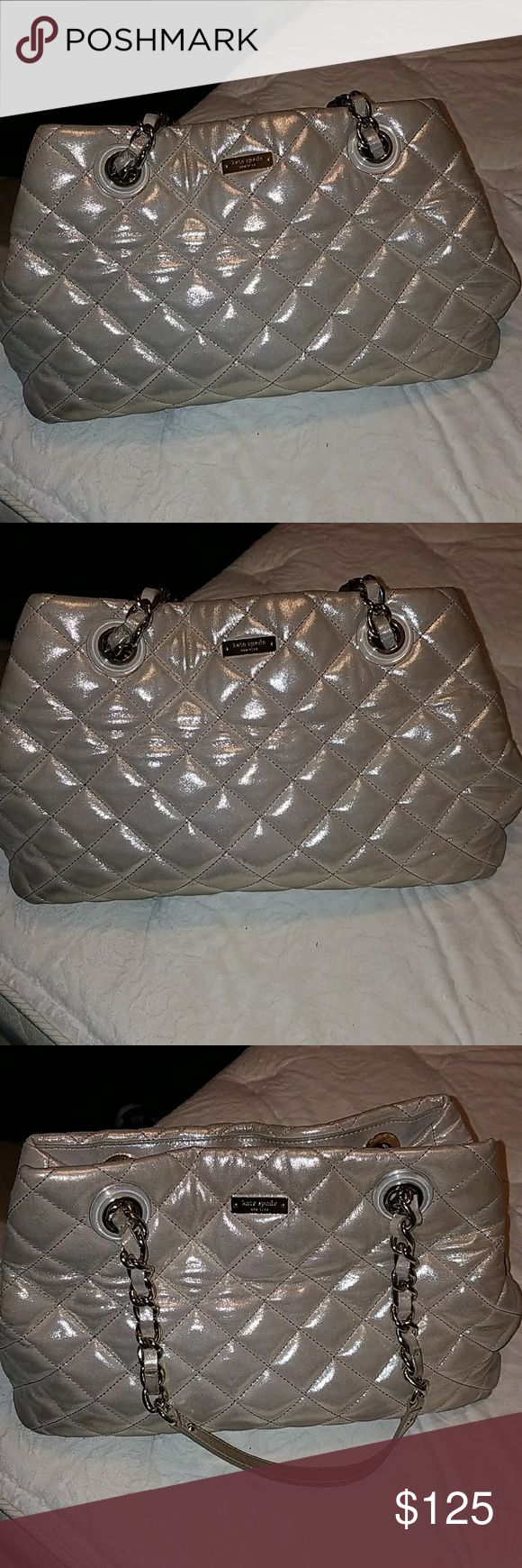 Kate spade gold coast bag Quilted fabric tote in a metallic gold.  Great condition.  Large bag.  Snap top closure with a zip divider in the middle of this bag.  Plenty of space for all your daily needs plus some extra!  16x10 inches kate spade Bags Shoulder Bags