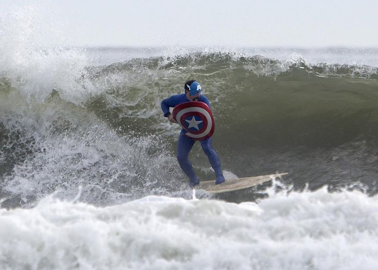 Captain America surfs during the third annual Rockaway Halloween surf competition at Rockaway Beach in the Queens borough of New York : yahoo 2013