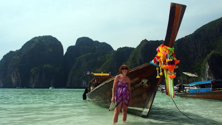 Shon and a runner boat, Phi Phi Island