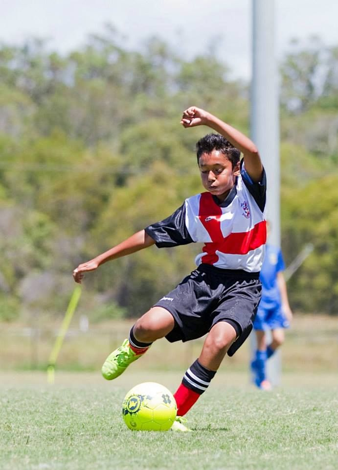 2014 Youth Photography Competition: Finalists, Ages 12-14. Runner up: 'Cousin playing soccer', by Aman.