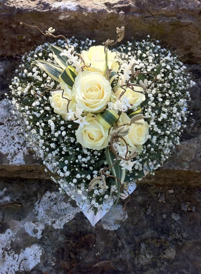 Gypsophila heart with White roses and white ribbon edge