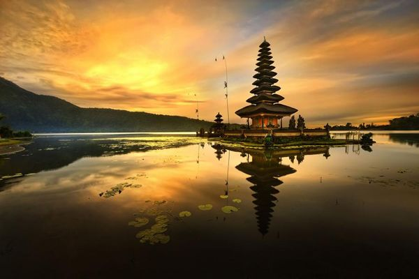 Ulun Danu Temple is a Balinese Hindu Temple located at Candi Kuning Village, Baturiti Sub-district, Tabanan regency. From Denpasar town is about 50 km or 2 hours. It is set at lakeside of Beratan with beautiful lake view, cool atmosphere and hills as a background.