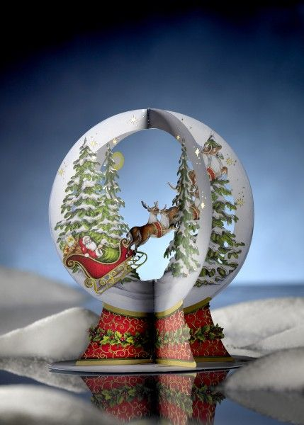 The four wings, with the detailed cutouts, folds out to form a cross. Now you can place the papercut on the included base and thus form the card to a beautiful decoration.  The papercut can be folded together and reused.  Find out more about this special greeting card: http://www.ducklingcards.com/store/christmas/snow-globe.html