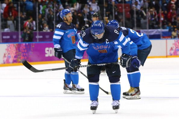 Teemu Selanne #8 of Finland looks down after losing to Sweden 2-1 during the Men's Ice Hockey Semifinal Playoff (c) Getty Images