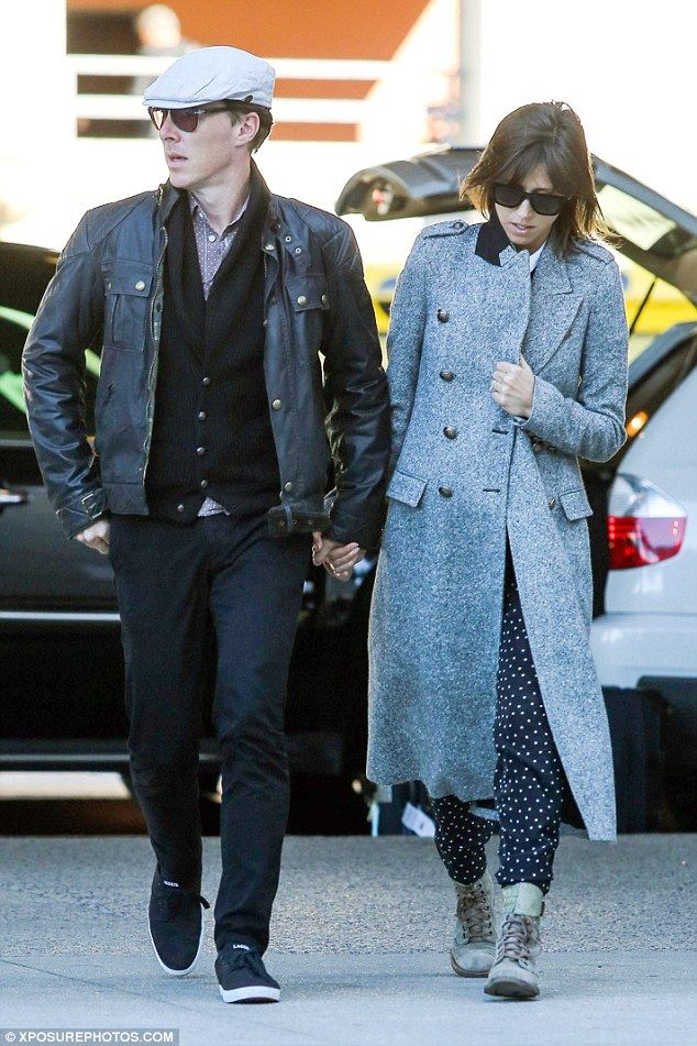 Show of affection: Benedict Cumberbatch broke millions of fans' hearts by arriving at LAX airport on Sunday afternoon holding his fiancée Sophie Hunter's hand