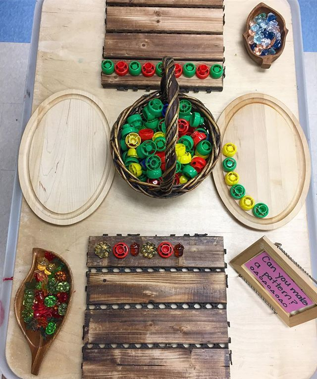 A welcoming Reggio Pattern provocation invites Mathematical thinking with Recycled caps, buttons, etc. for Patterning with Loose Parts! (Via Instagram)