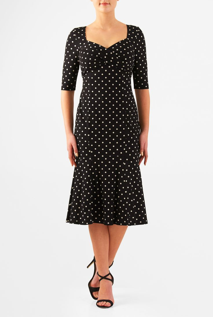 Our polka dot print cotton knit dress is styled with a sweetheart neckline, surplice bodice and flounce hem skirt for classic flattery.