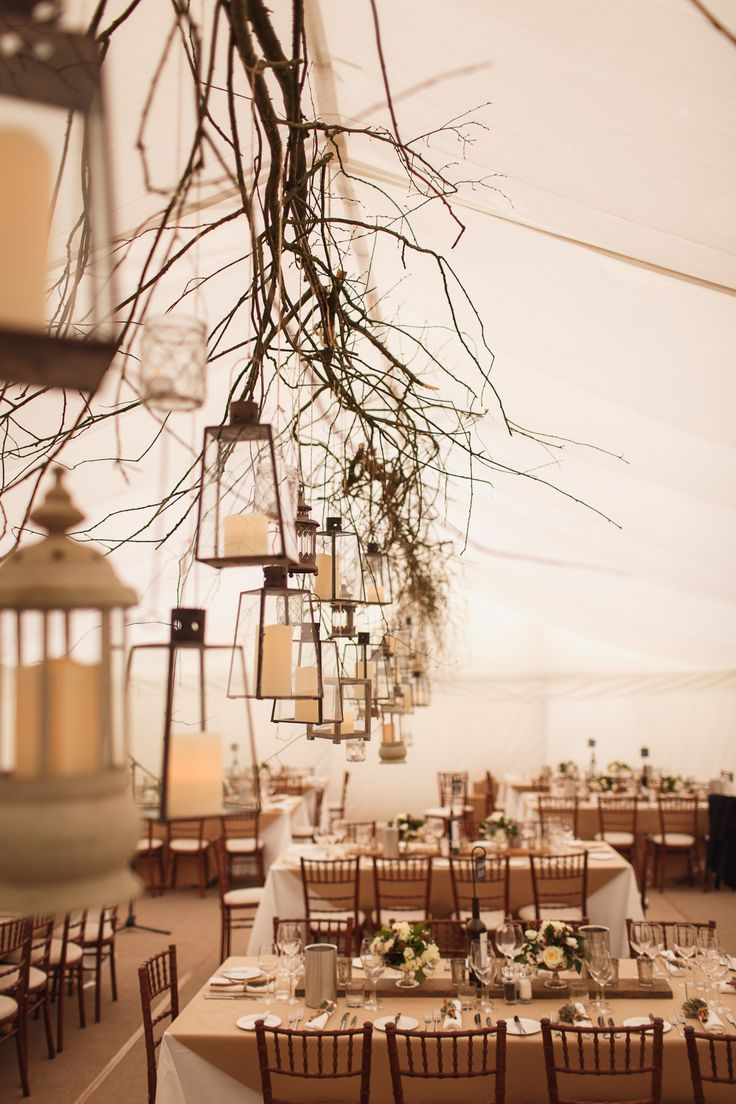Rustic, winter, wedding marquee...hanging twigs and lanterns!