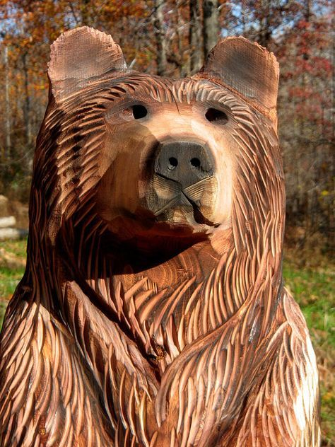 Mark has chainsaw carved several of these adorable bear cubs from cedar, poplar or pine logs. They have a rustic style while still showing