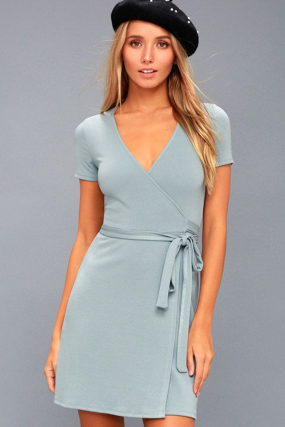 ca79e8f4a2 You'll be a vision of perfection in the Belvedere Light Blue Wrap Dress!  Soft jersey knit fabric sweeps down fitted short sleeves into a wrapping  bodice ...