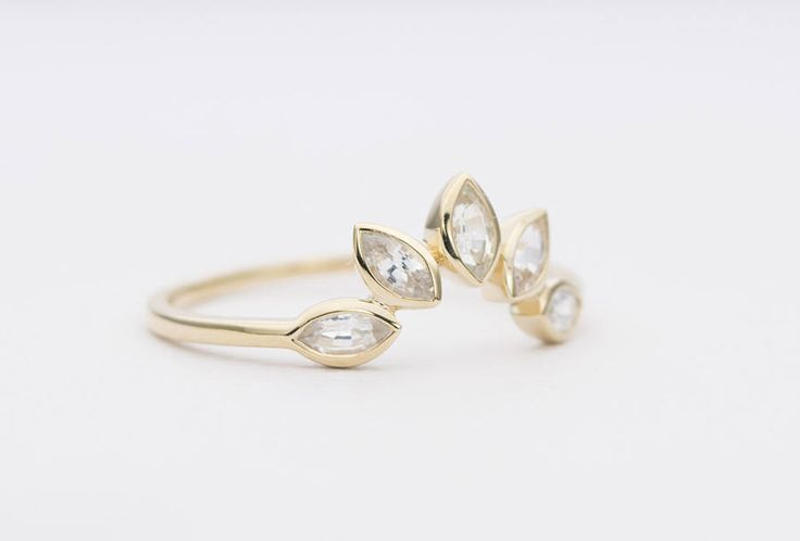 ♥ ♥ All size/color combos listed here are in stock and ready to ship right away. For other sizes or gold colors, please use this listing to purchase a ready-to-made item: https://www.etsy.com/listing/503096394/marquise-white-sapphire-14k-gold-wedding ♥ ♥  ♥ A curved crown ring set with five marquise-shaped white sapphires, forming a gentle hug that will go around your engagement or solitaire ring so beautifully! ♥ Set on solid 14K gold ♥ US Size 6.25 (should work...