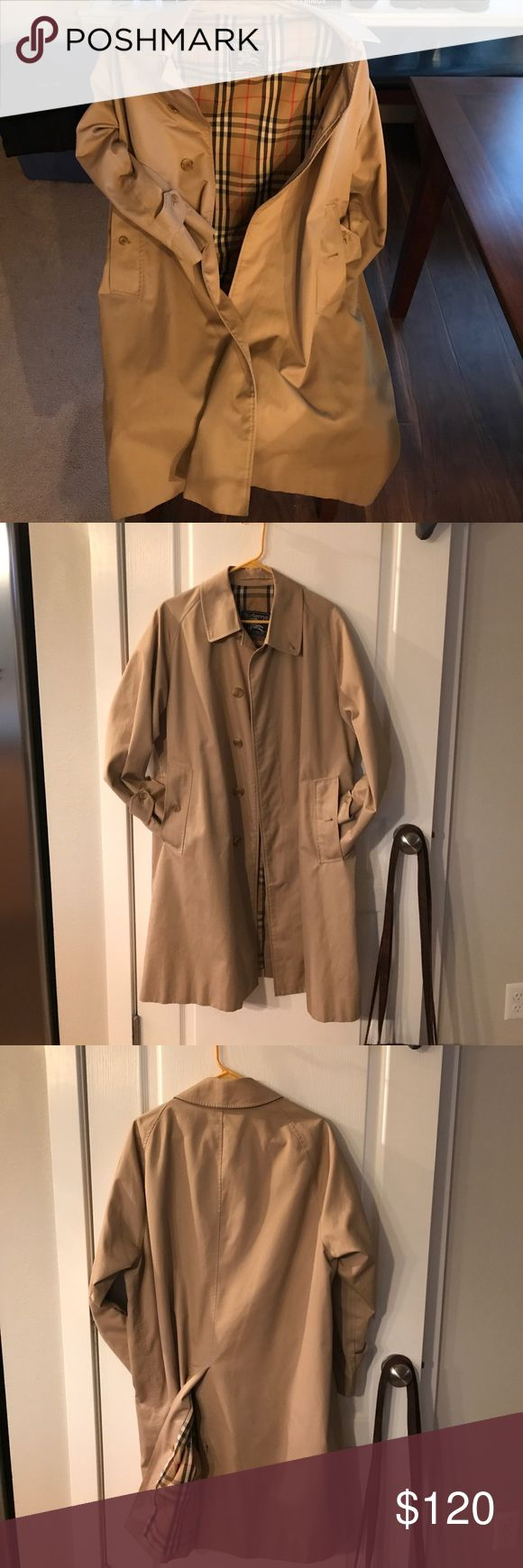 Burberry Rain Coat/Duster Women's or Men's New I bought this in 1990, when I was 9 months pregnant so I bought a large, I think. No size indicator. I wore it for one month. No stains, scratches. All buttons and fabric looks brand new. No wear marks at all. Burberry Jackets & Coats Trench Coats