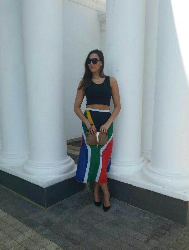 South african skirt with black crop top, skin clutch