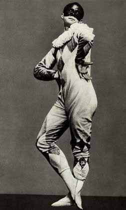 Michel Fokine in Harlequine costume wearing a black mask, c.1910. (Photographer…