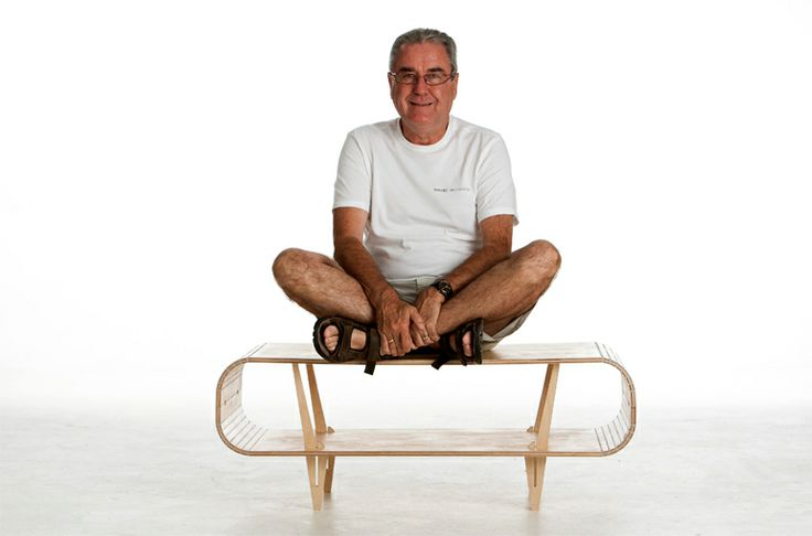 The new flat pack - Stratflex Orbit coffee table, with it's designer sitting on it, by Wintec Innovation. www.wintec.co.za