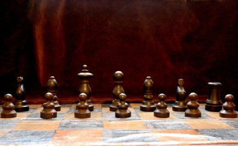 This is an #original set of The Athenaeum's turned wood #chess pieces. There are 25 chess pieces including 2 dark Bishops, 2 dark Knights, 2 dark Rooks, 6 dark Pawns, 1 light Bishop, 1 light Rook, and 8 light Pawns. In order to complete this set, 6 replica pieces were made in 1983 by Daniel H. Barol. The replicas include 2 dark Pawns, 1 light Rook, 1 light Knight, 1 light Bishop, and 1 light King.