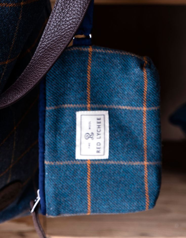 Vineyard Wool Wallet. This elegant wallet/pouch is perfectly sized to hold your phone, credit cards, lipstick, and other small essentials. It's also perfect for packing into your luggage or stowing in your handbag.