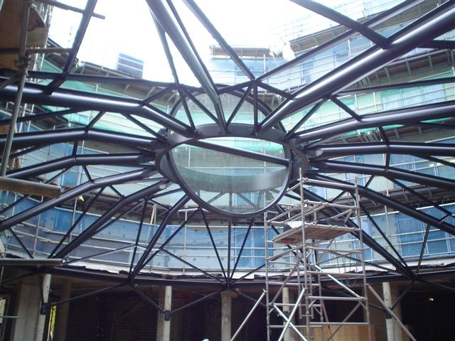 Glazing Vision Rooflights, Skylights and Glass Roofs Portfolio- Collin Theatre    1 No. Central pivoting Rotating Circular Rooflight, Diameter 3125mm. The Rooflight will pivot on a central axis to 90 degrees. The unit is split into two halves with a pivot and axis detail through the centre.