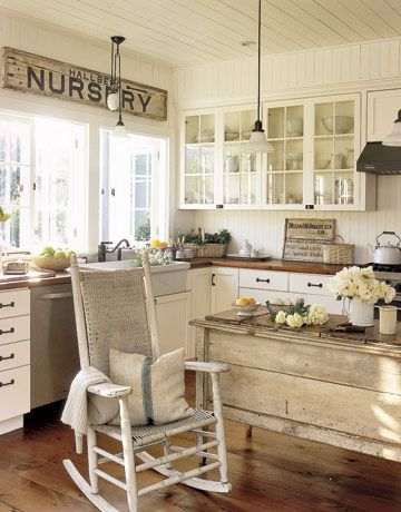 Don't be afraid to cover many surfaces with wood. Even the kitchen countertops in this California kitchen are crafted from salvaged wood floors. The pulley lights are faithful reproductions of 19th-century versions. RELATED: 12 Decorating Ideas for a Cozy Kitchen   - CountryLiving.com