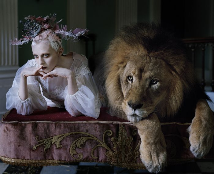 This photograph was taken by Tim Walker. I find this photo really interesting because the model is casually posing next to the lion instead of being fearful of it and that the lion is posing on the couch as well.