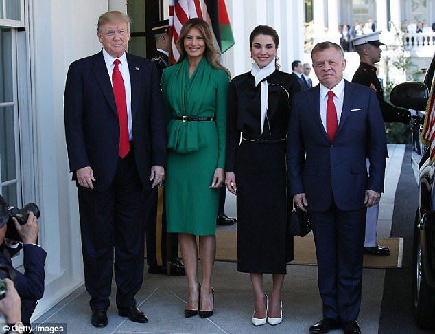 PICTURE PERFECT: U.S. President Donald Trump and his wife First Lady Melania Trump welcome King Abdullah II Hussein of Jordan and his wife Queen Rania of Jordan at the West Wing of the White House. Trump and Abdullah both wore blue suits with red ties for the occasion - and their wives had on dresses, each sporting a black bel