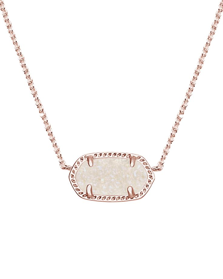 An iridescent drusy stone shines against a rose gold silhouette forming this classic Kendra Scott pendant necklace. Lobster Claw Closure. 14k Rose Gold Plated Brass.
