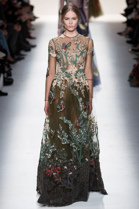 Look 68, Valentino Fall 2014. Another of many variations on a theme: wondrous garden-of-eden motif on transparent tulle, with a simple silhouette: high neck, long sleeves, shirt waist with dirndl skirt. So, they're taking the simple and making it extraordinary!